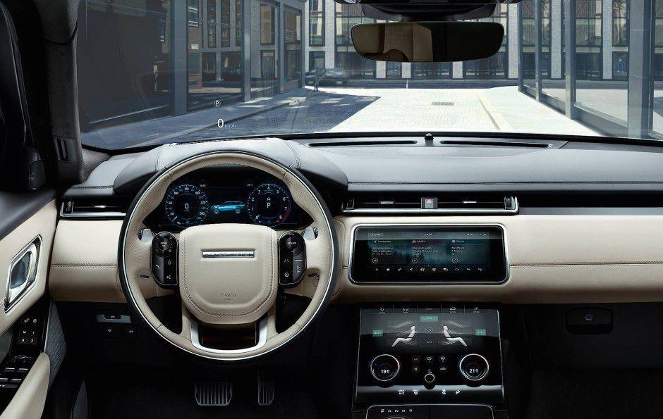 Der noble Innenraum des Range Rover Velar hat ein auf Touchsteuerung ausgerichtetes Hightech-Infotainment- und Bediensystem