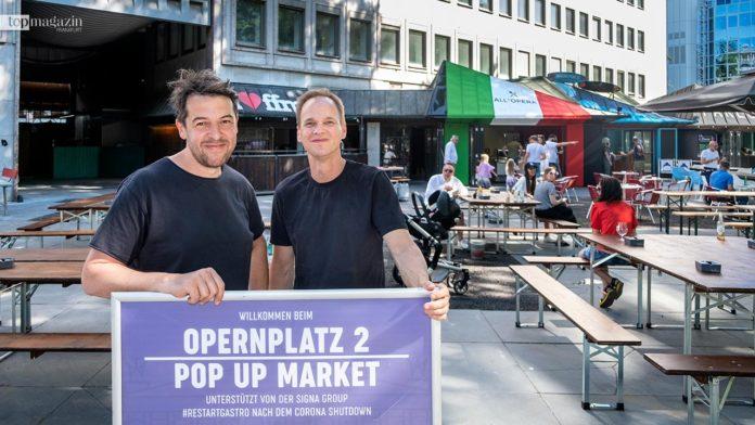 Naiv-Inhaber Sascha Euler und Geschäftspartner Christian Daam freuen sich über die Eröffnung des neuen Pop-up-Market am Opernplatz.